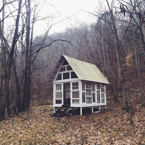 Artist Studio Overlooks Guest Cabin With Rooftop Garden: White Shack In The Woods All Windows