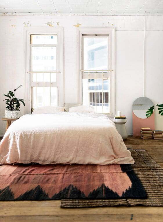 Bohemian Bedroom With Layered Rugs