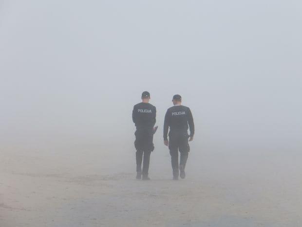 men in fog