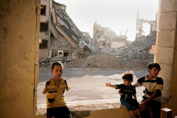A refugee family lives amid the rubble in Ramadi, an Iraqi city leveled by ISIS's destruction and bloodshed.